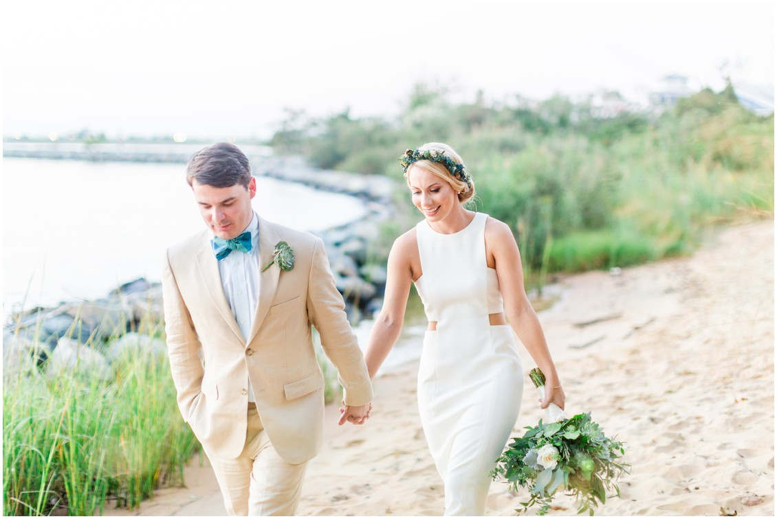 Bride and groom walking along the beach at Chesapeake Bay Beach Club. | My Eastern Shore Wedding |