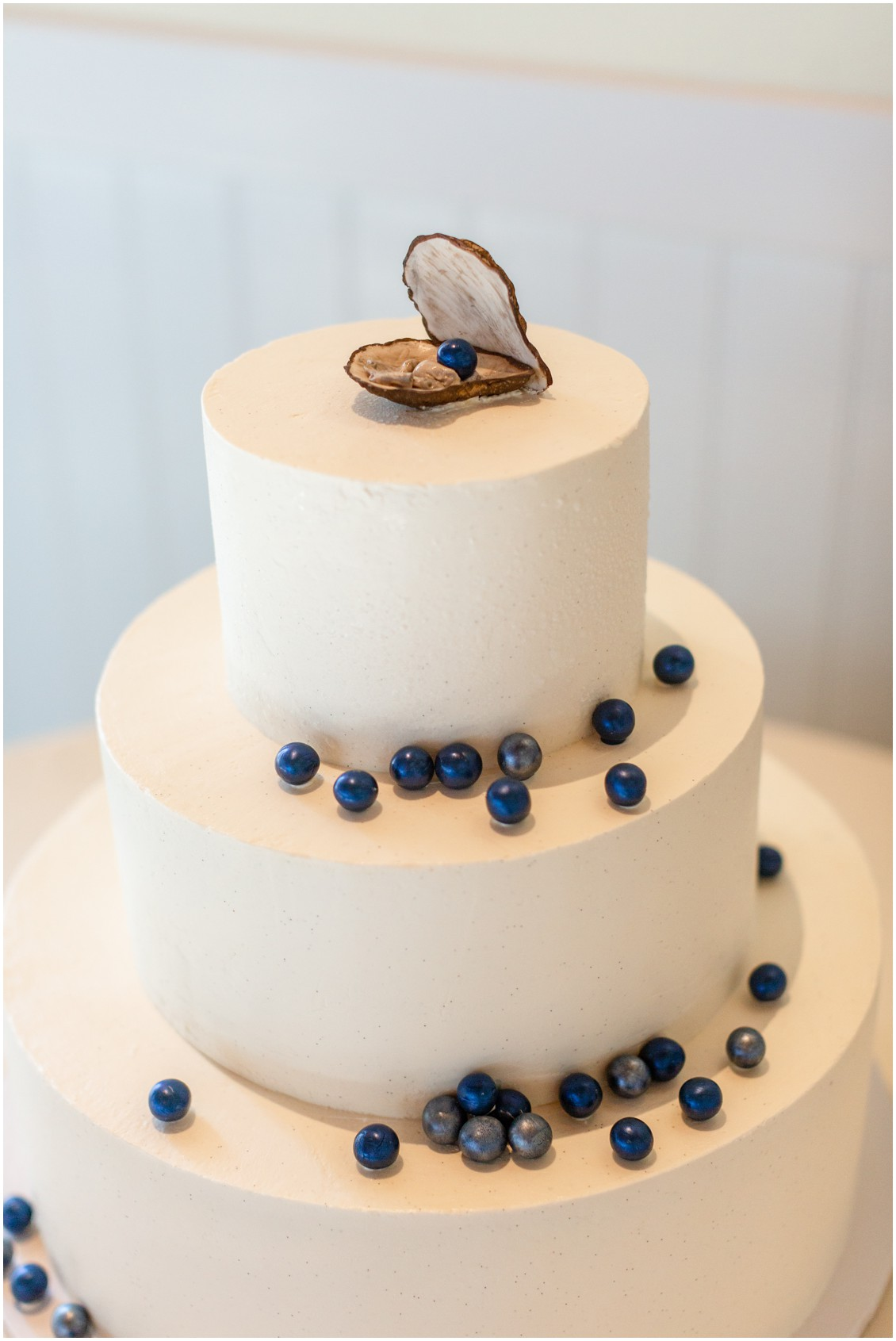 Oyster topped wedding cake with edible blue pearls  by Delaney's Delectables. | My Eastern Shore Wedding |