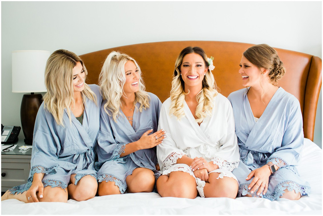 Bride with bridesmaids in matching blue bathrobes. | My Eastern Shore Wedding |