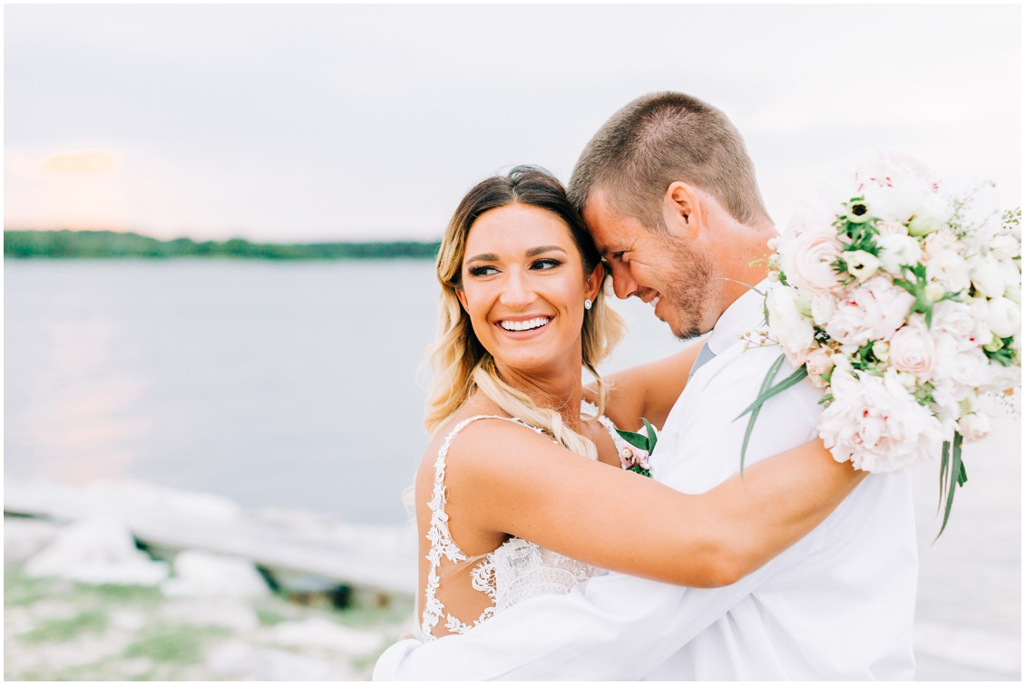 Bride and groom by the water at Tred Avon Yacht Club | Sherwood Florist bouquet | My Eastern Shore Wedding |