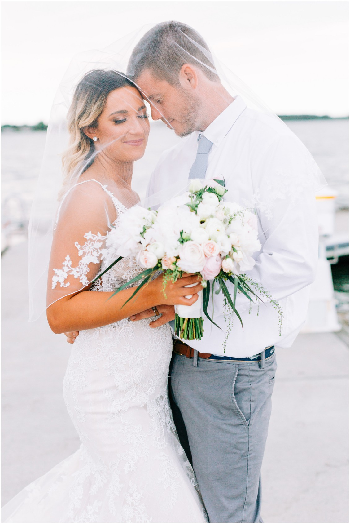 Bride and groom at Tred Avon Yacht Club | Couple under bride's wedding veil | Sherwood Florist | My Eastern Shore Wedding |