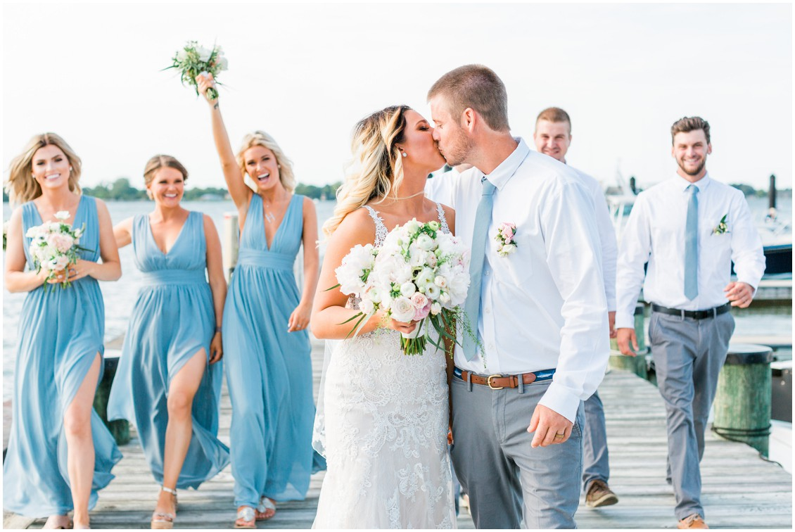 Tred Avon Yacht Club | Bridal party on dock | Blue bridesmaid dresses | My Eastern Shore Wedding |