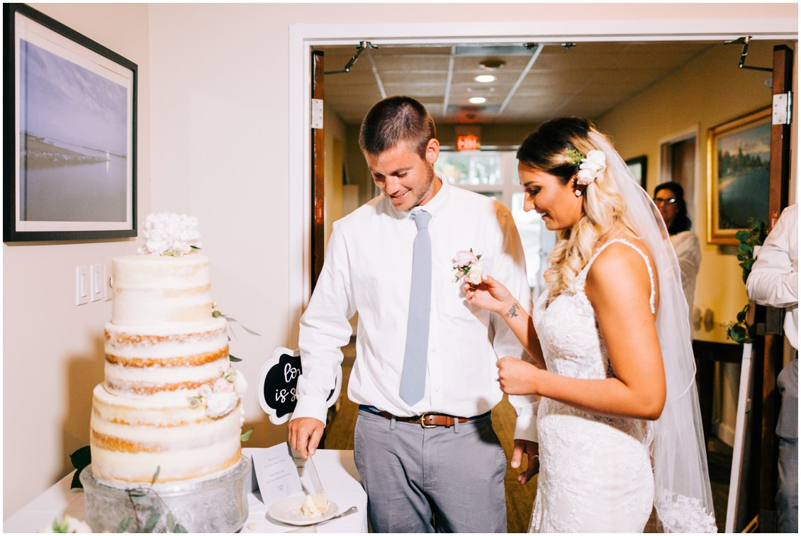 Bride and groom eating first slice of wedding cake | My Eastern Shore Wedding |