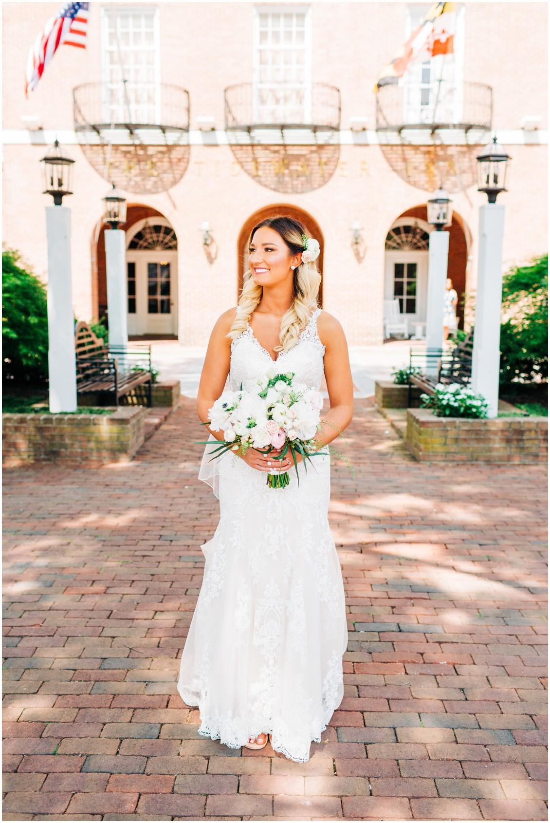 Bride holding Sherwood Florist bouquet | Tidewater Inn | My Eastern Shore Wedding |