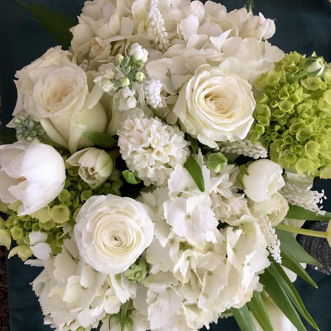 Close-up of large white and green bridal bouquet made by Chesapeake Blooms on the Eastern Shore
