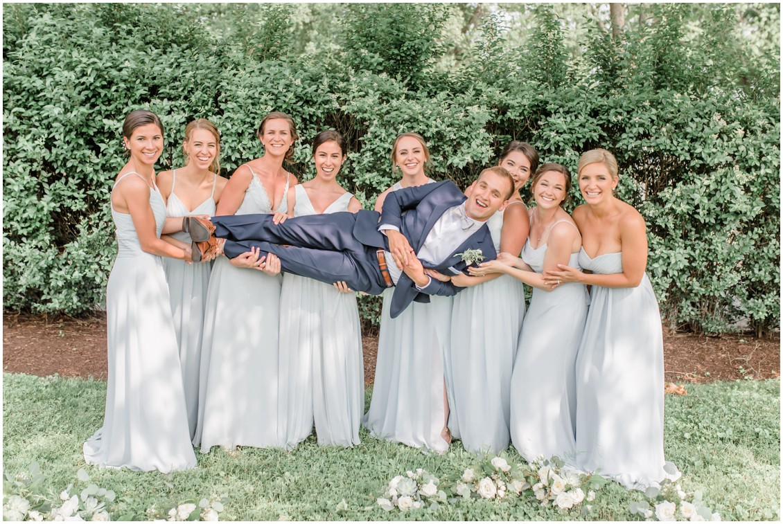 Bridesmaids holding up the groom shot | My Eastern Shore Wedding |