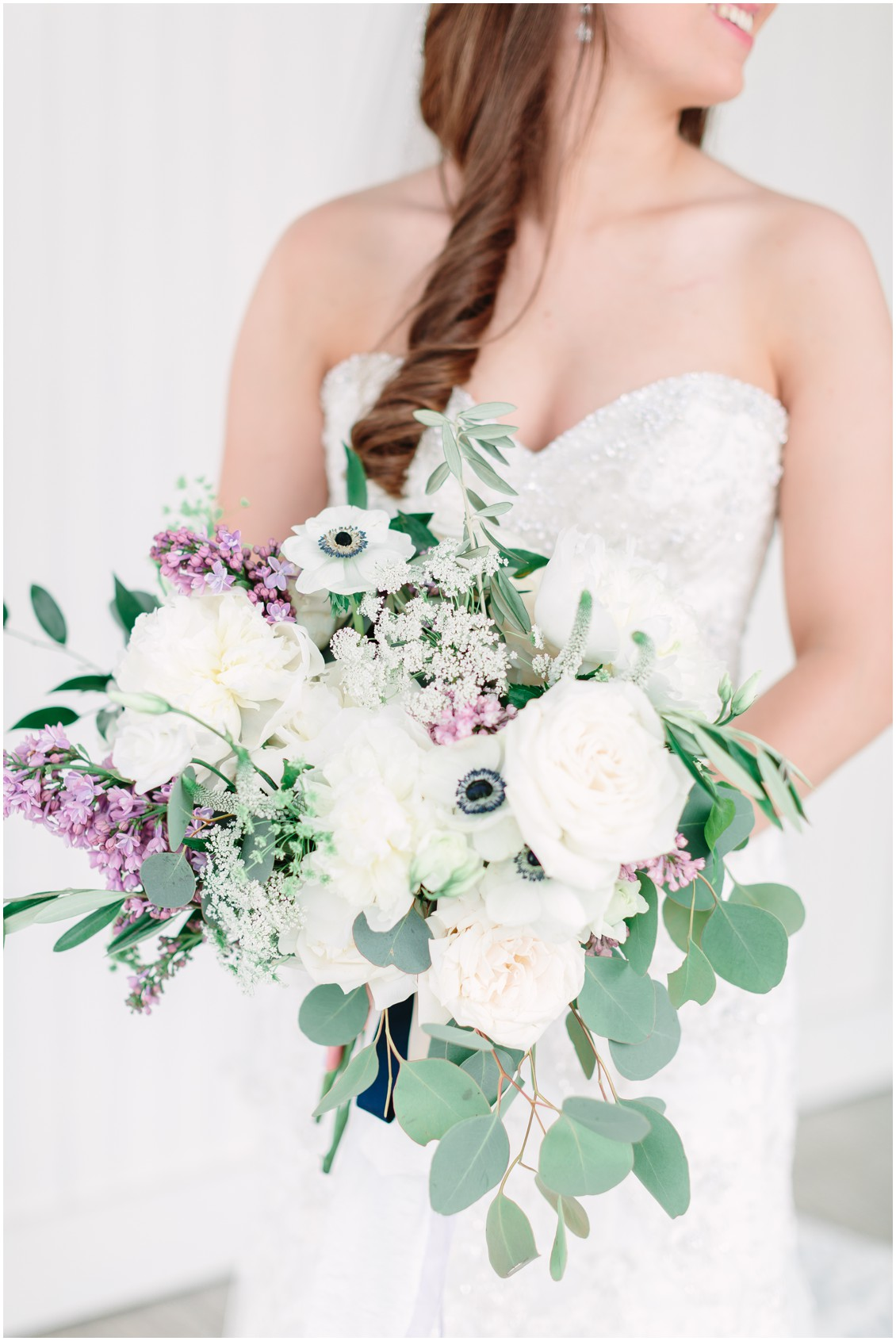 White and purple floral wedding bouquet | Bride in strapless, lace wedding gown | My Eastern Shore Wedding