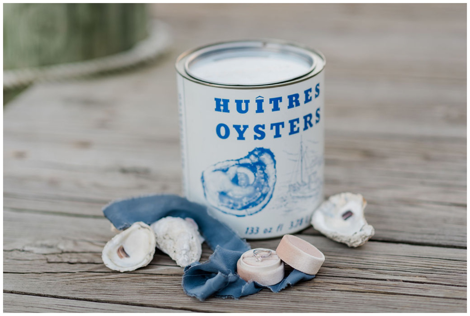 huitres - oysters - madison seafood company - maryland - dock - pier - outdoor coastal - bay inspired photoshoot - engagement ring and velvet ring box styling with oyster shells - coastal - nautical ideas