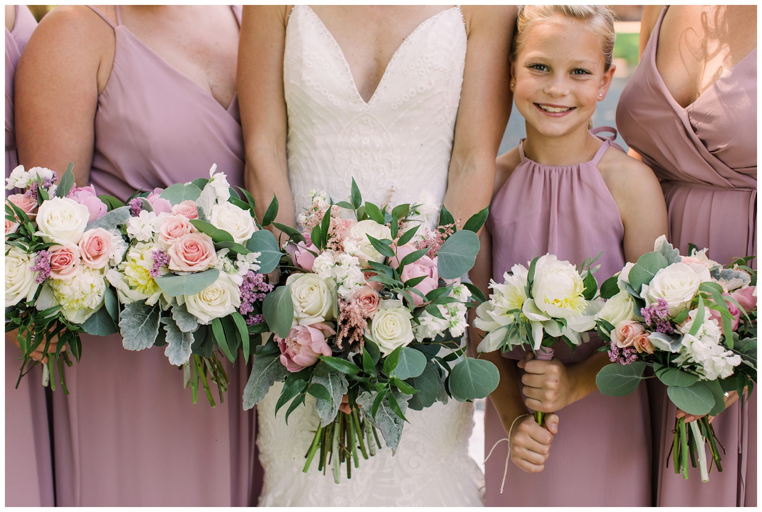 sweet as honey bee inspired wedding at worsell manor maryland on My Eastern Shore Wedding - coastal - sea - nautical - eastern shore - inspired wedding ideas and inspo - photo of pink and purple florals closeup with light purple bridesmaid dresses and matching flower girl dress and bride's wedding gown