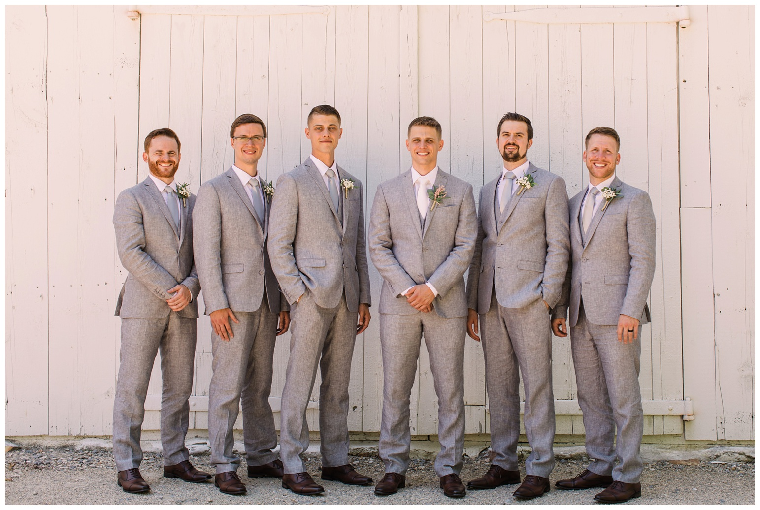 worsell manor wedding in the summer - warwick md - now featured on My Eastern Shore Wedding - coastal - sea - nautical - eastern shore - inspired wedding ideas and inspo - photo of groom and groomsmen - wedding party - in front of barn like wall door - white - formal portrait photo outdoors on maryland eastern shore