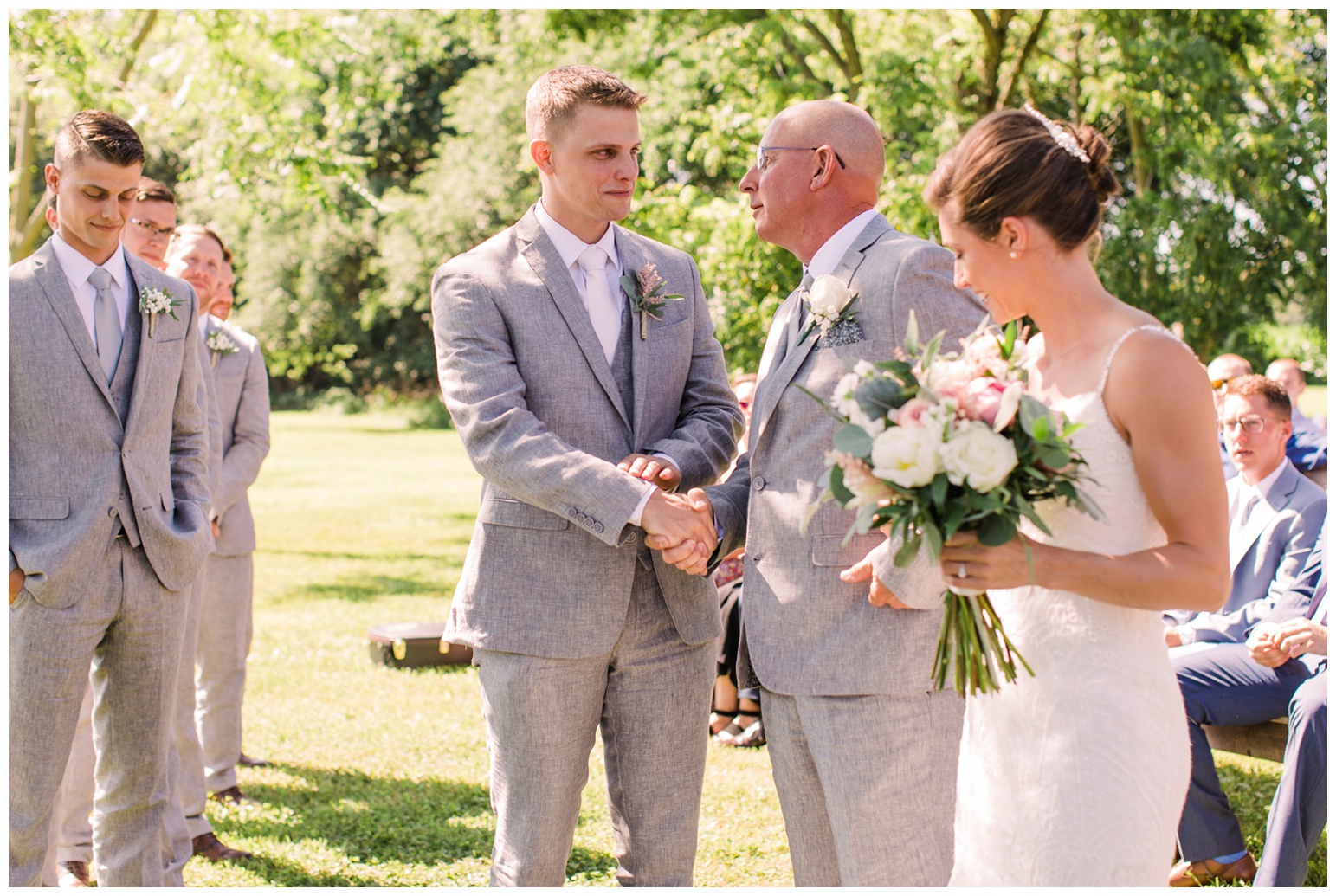 outdoor wedding ceremony photo of father of the bride shaking grooms hand at worsell manor - summer wedding inspiration