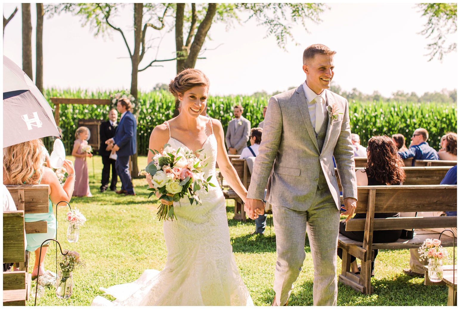 outdoor wedding reception at worsell manor - summer wedding - bride and groom walking down the aisle just married - ceremony photo in maryland
