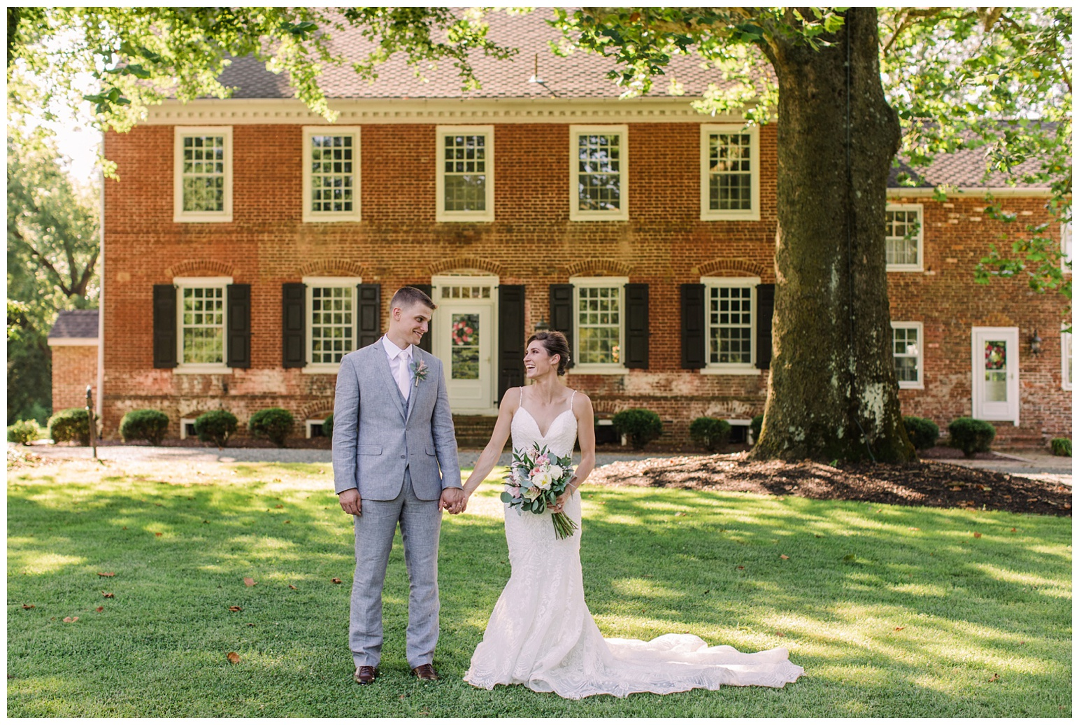 worsell manor wedding in the summer - warwick md - now featured on My Eastern Shore Wedding - coastal - sea - nautical - eastern shore - inspired wedding ideas and inspo - photo of bride and groom outdoors in front of brick manor style building