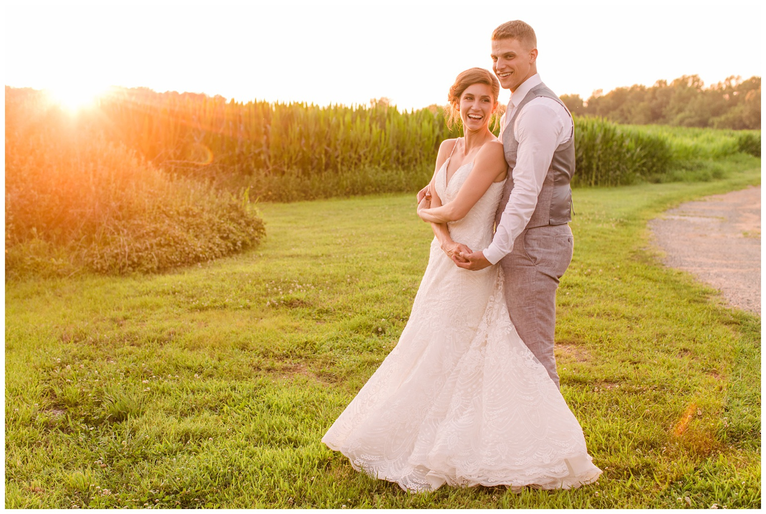 worsell manor wedding in the summer - warwick md - now featured on My Eastern Shore Wedding - coastal - sea - nautical - eastern shore - inspired wedding ideas and inspo - photo of bride and groom outdoors at sunset - golden hour - in front of corn field