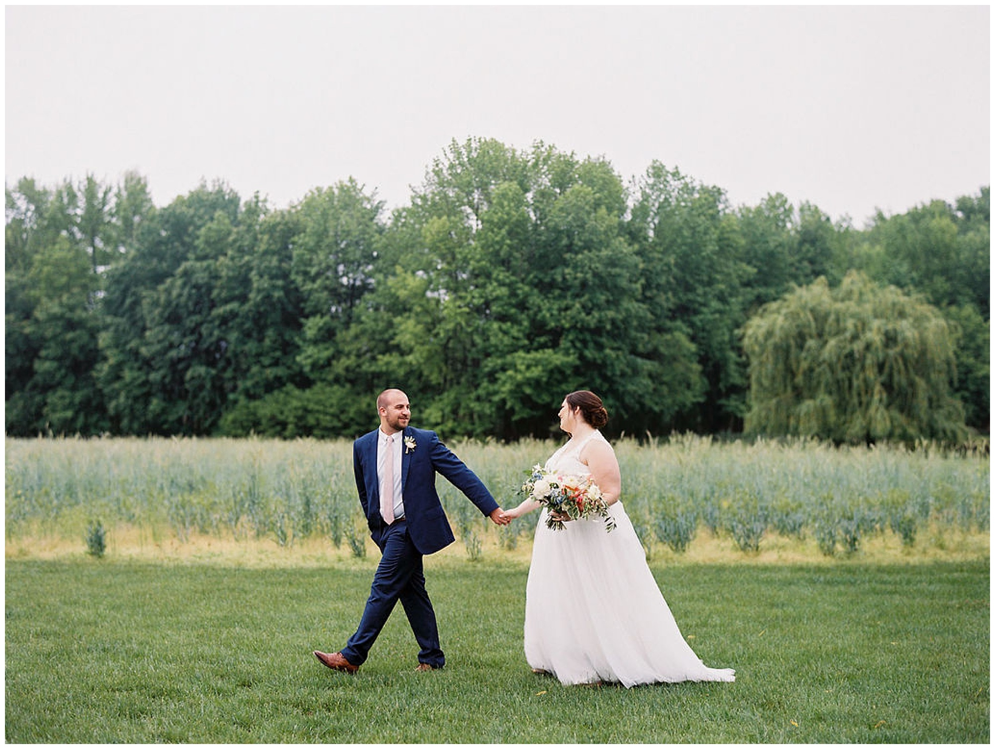 formal wedding portrait outdoors; even on a rainy day. this entire wedding at maryland eastern shore at the inn at huntingfield is so pretty and is full of timeless wedding inspo