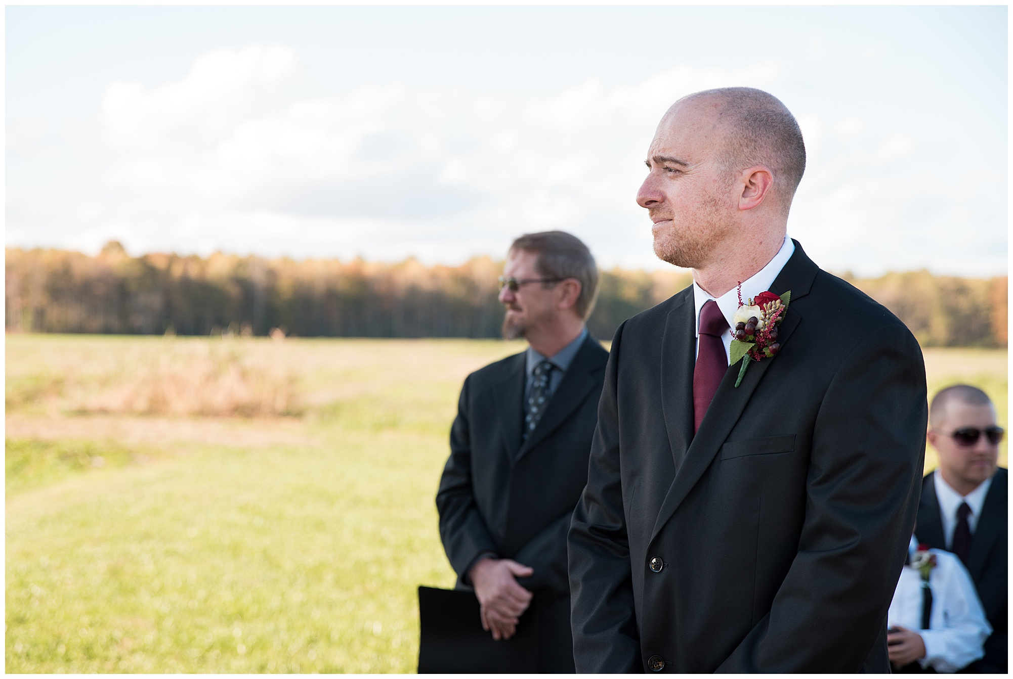 groom waiting for bride at the start of the ceremony. wedding photos outdoors at covered bridge inn in lewes delaware. historic wedding barn venue on the eastern shore. fall wedding in november with rustic decor theme.