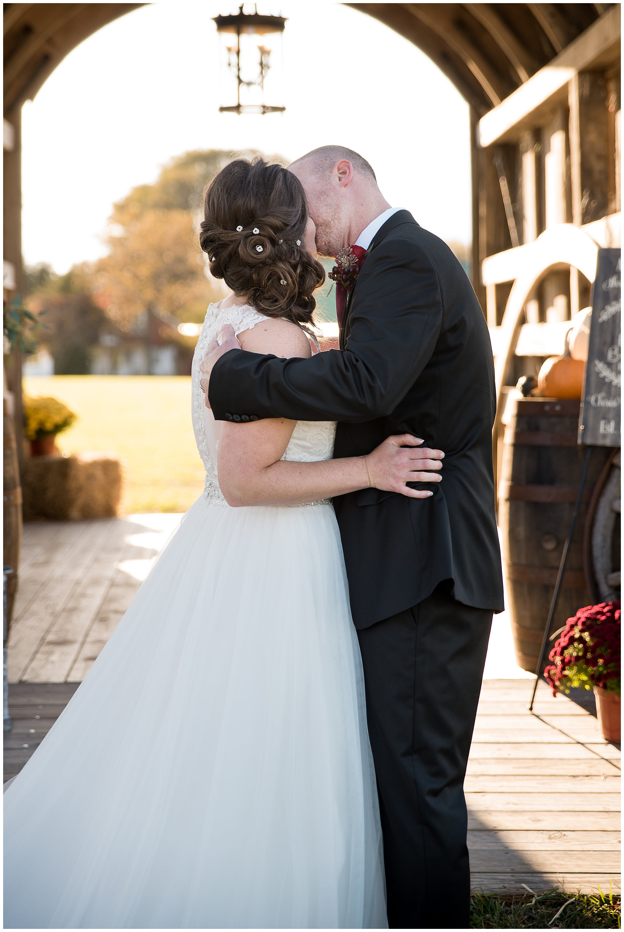 just married! wedding photos outdoors at covered bridge inn in lewes delaware. historic wedding barn venue on the eastern shore. fall wedding in november with rustic decor theme.