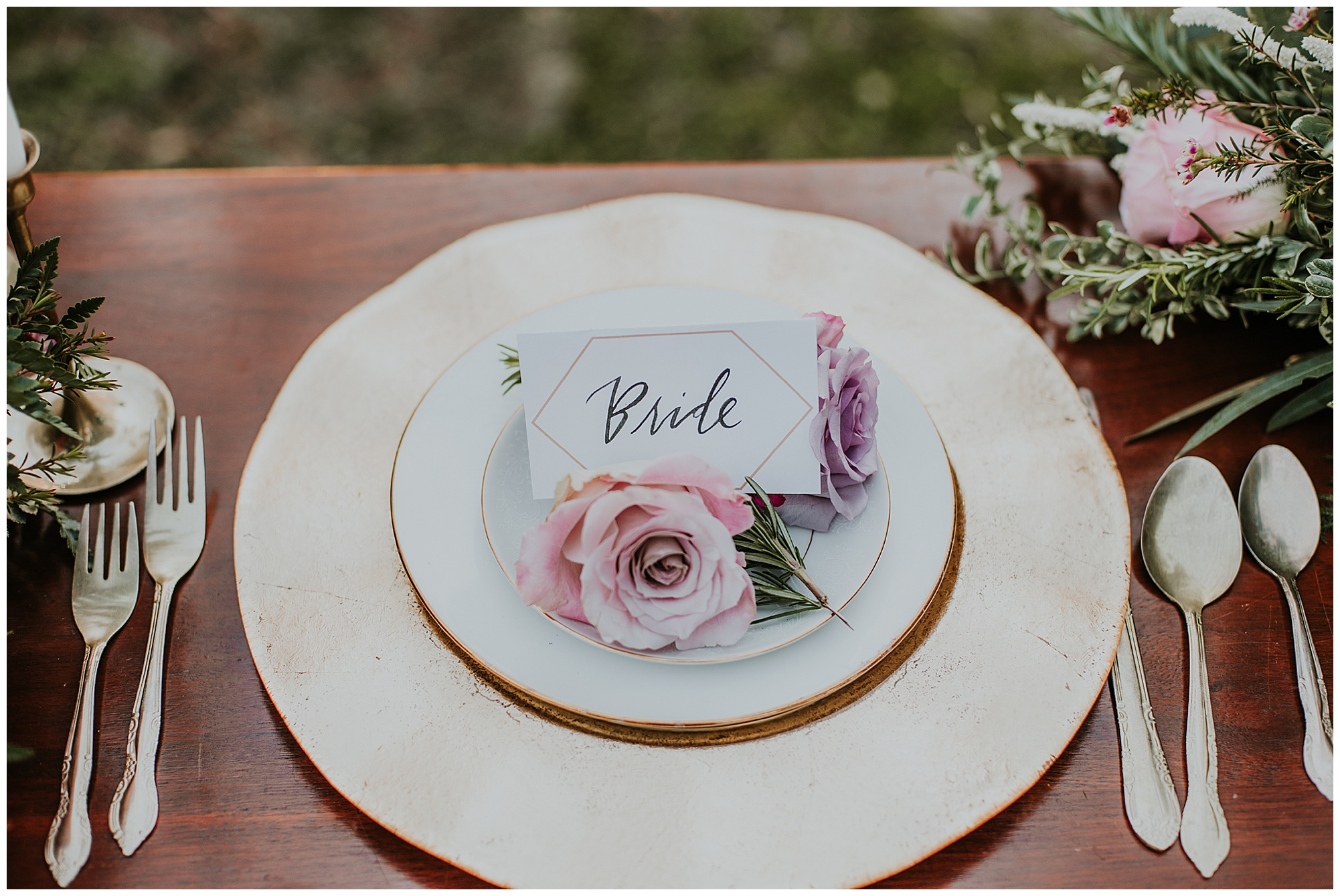 romantic and vintage style table setting with roses, rosemary, greenery, and gold.