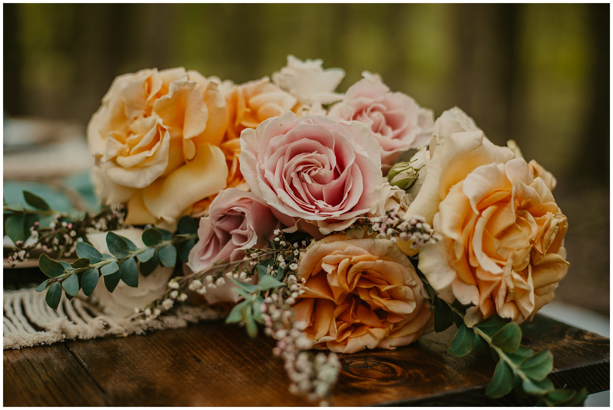 pastel flower bouquet with light peach, pink, and greenery   eco friendly style wedding at prancing deer farm now featured on my eastern shore wedding blog