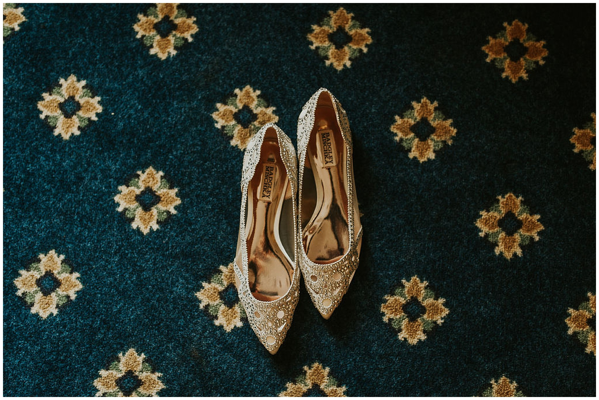 badgley mischka wedding shoes with kitten heels and pointed toe on blue and yellow carpet at the tidewater inn venue in easton maryland