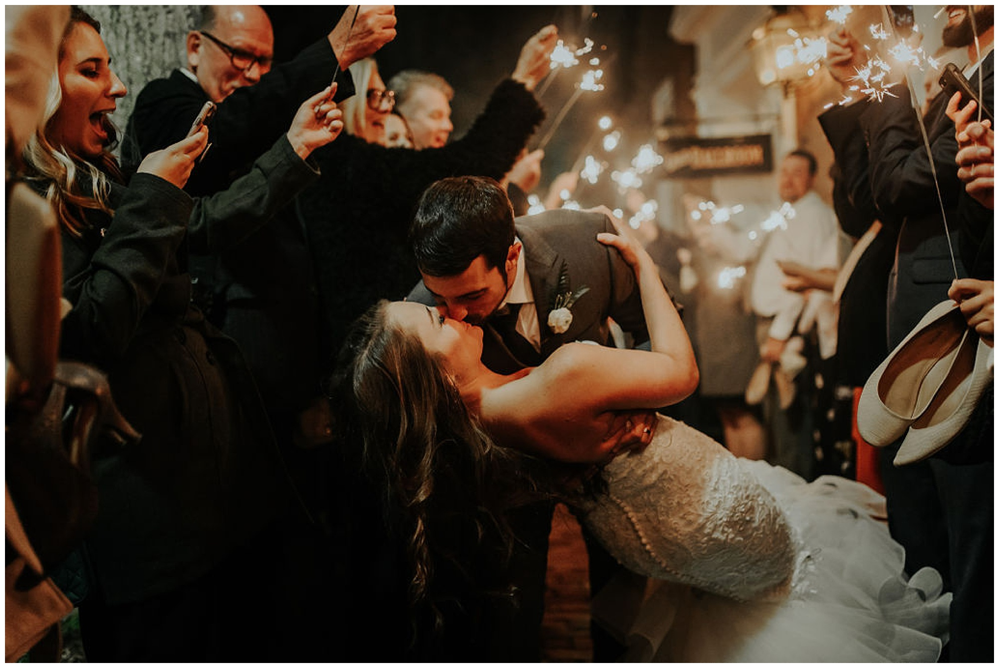 cue the confetti and fireworks for this autumn and fall wedding at the tidewater inn venue in easton maryland now featured on my eastern shore wedding. grand exit with sparklers at historic venue. intimate moody sultry romantic and totally classic.