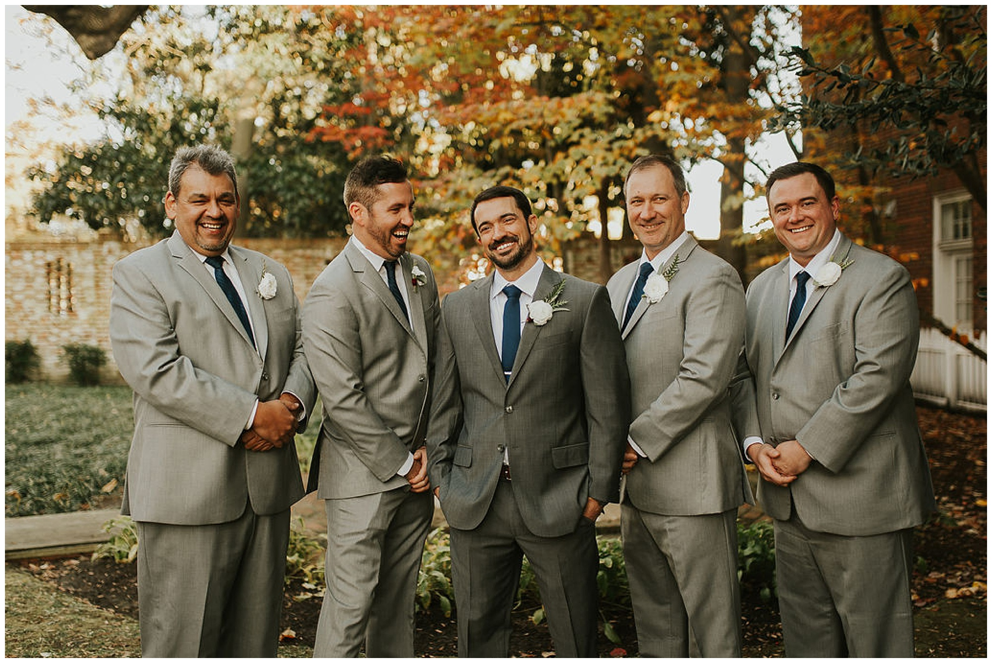 happy groom and groomsmen outdoors at the tidewater inn venue in easton maryland in the fall autumn. classic, yet coastal wedding inspo from maryland eastern shore.