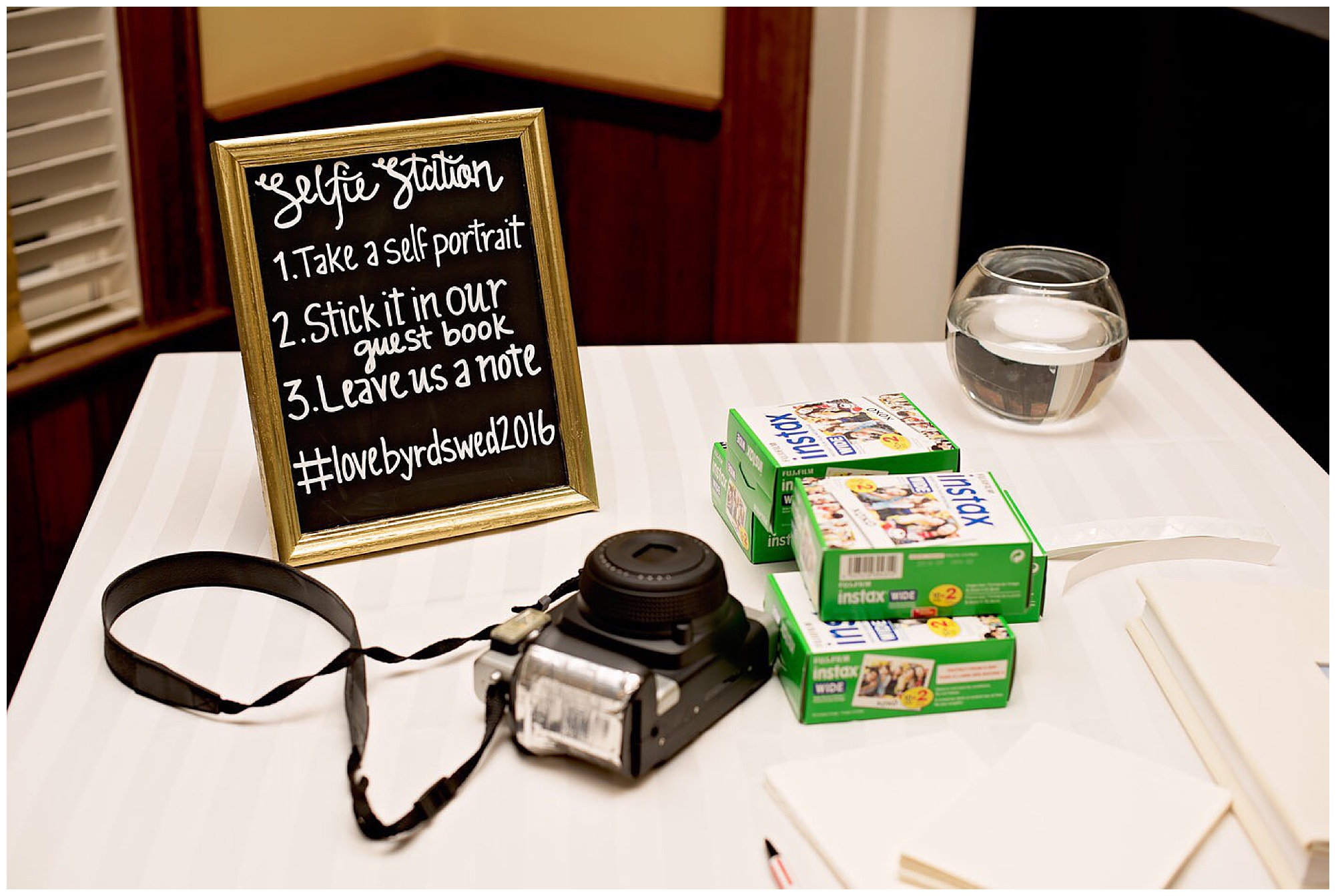 instructions for a selfie station on a table with polaroid camera and film. Photography by Jennifer Madino Photography