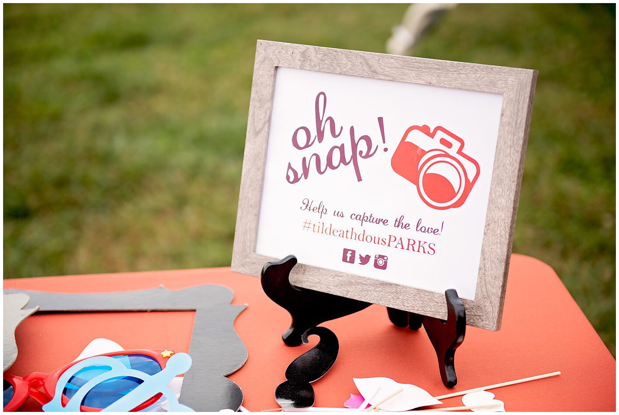 wedding signage on prop table for photobooth  at wedding. Photography by Jennifer Madino Photography