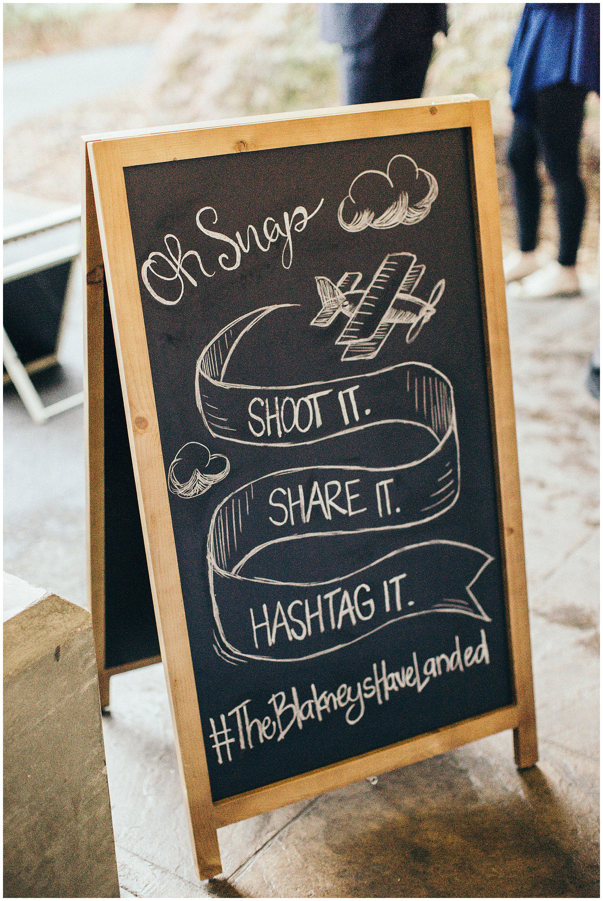 wedding hashtag on custom sandwich board sign idea at wedding. Photography by Jennifer Madino Photography