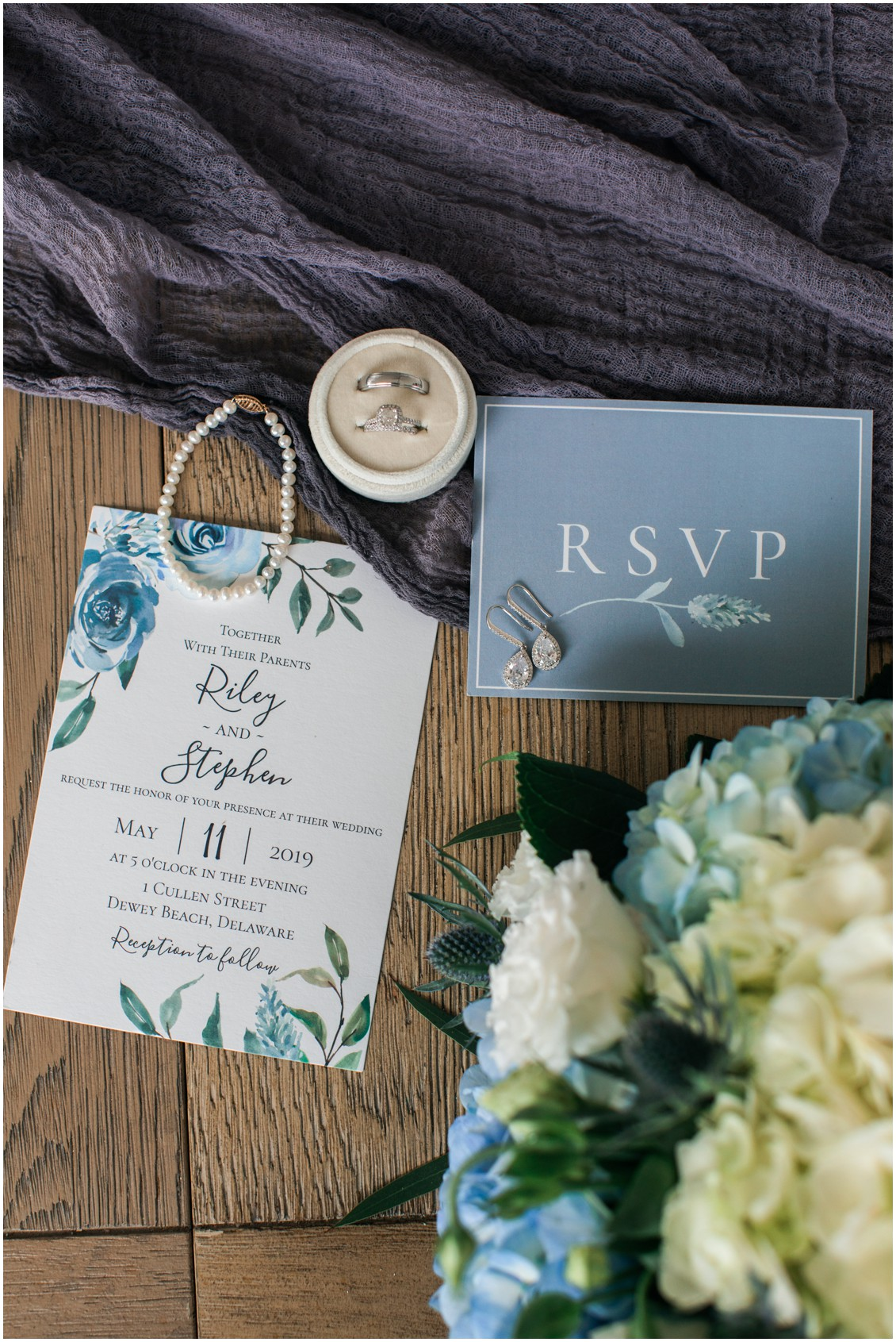 Flat lay  wedding rings wedding details and flowers  My Eastern Shore Wedding  Dover Tents and Events