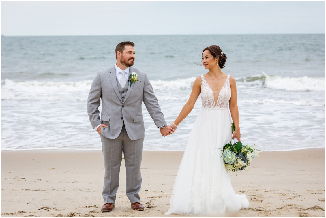 Bride and groom on the beach holding hands| My Eastern Shore Wedding |Dover Tents and Events