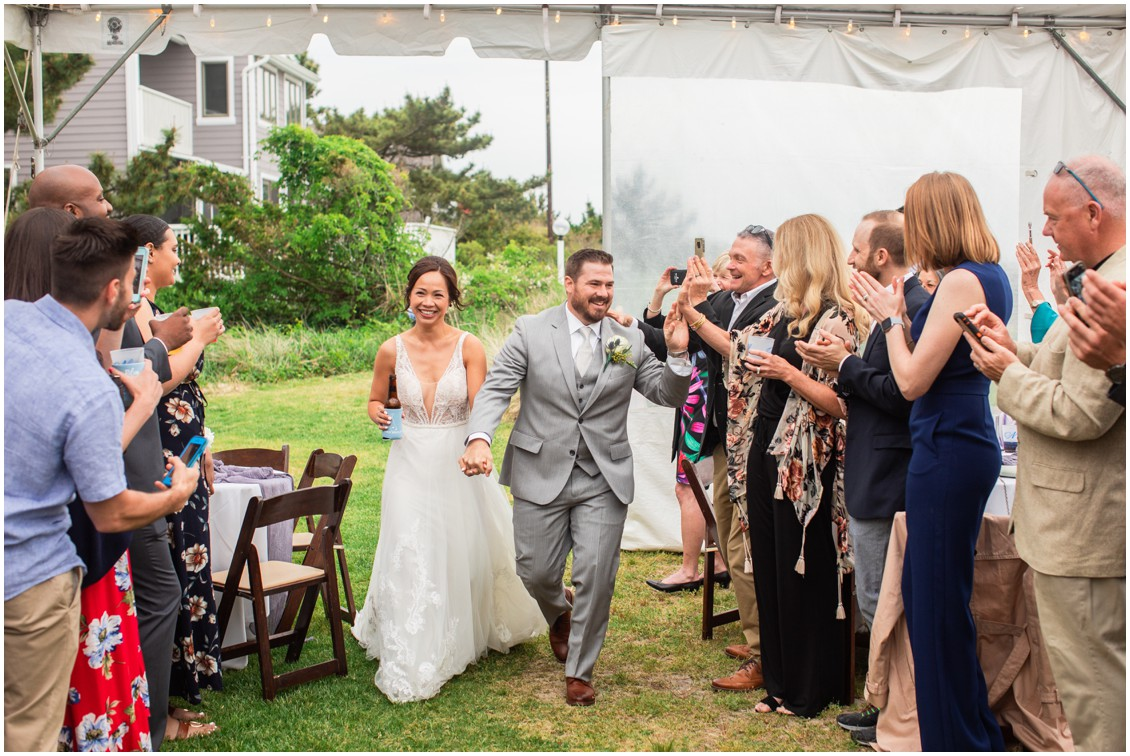 Bride and Groom walking into reception tent  | My Eastern Shore Wedding | Dover Tents and Events