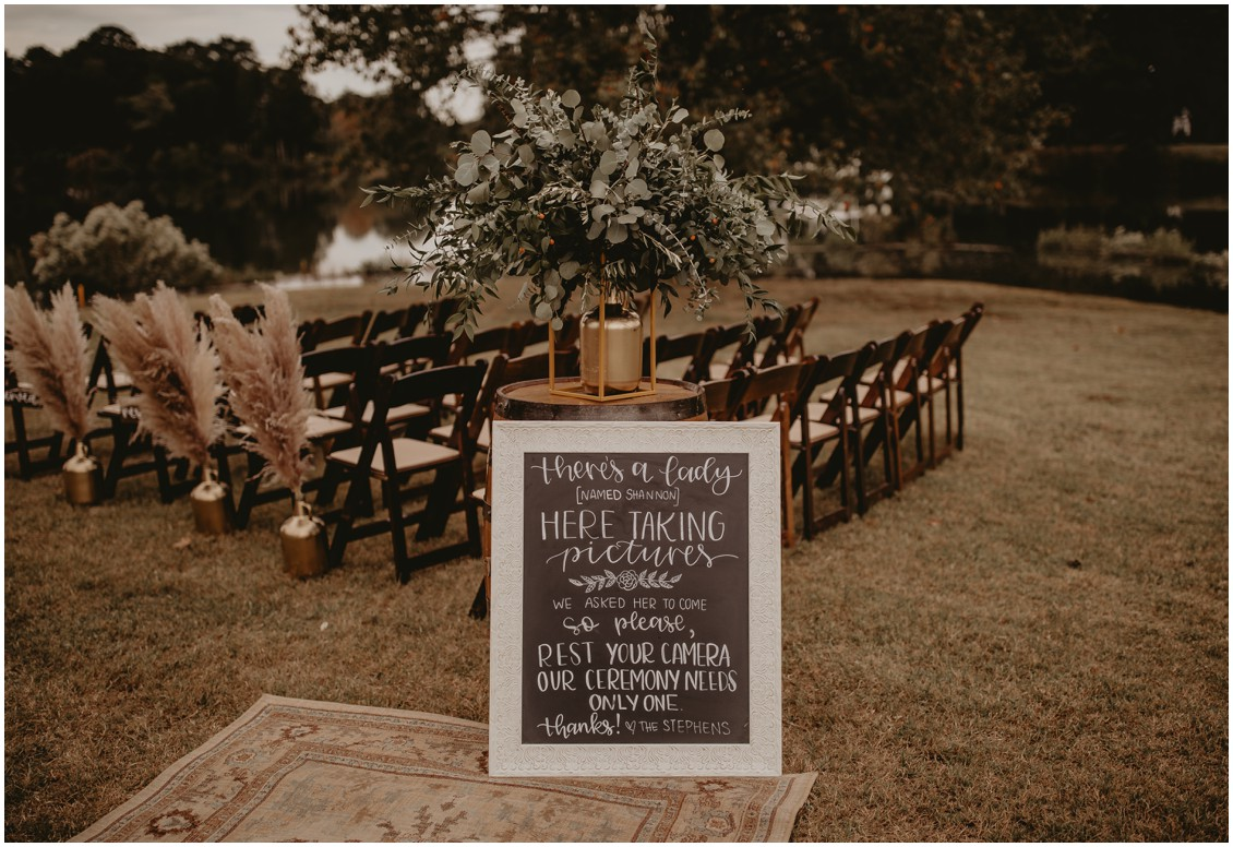 Wedding ceremony signage asking guests to rest their cameras, details of pampas grass and greenery | My Eastern Shore Wedding | Sherwood Florist | Mill Street Farm
