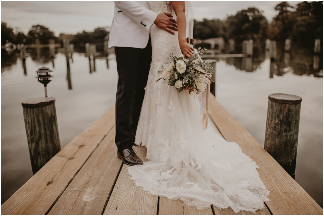 Boho chic bride and groom on dock  | My Eastern Shore Wedding | Sherwood Florist | Mill Street Farm