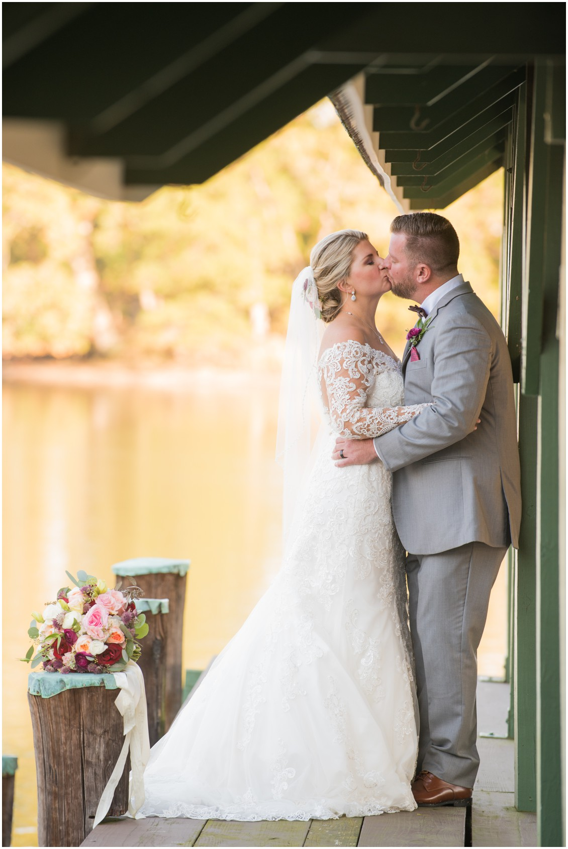 Bride and groom golden hour portrait kissing by the water | My Eastern Shore Wedding | The Oaks Waterfront Inn | Monteray Farms