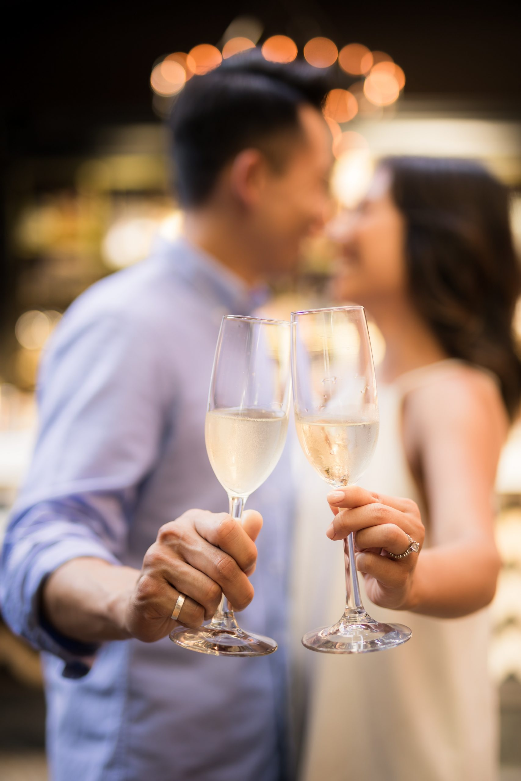 Couple holding champagne glasses | My Eastern Shore Wedding