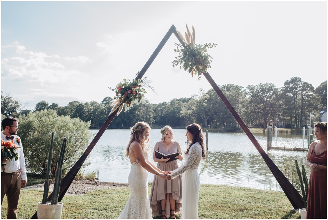 Wedding ceremony under geometric arch decorated with flowers boho wedding | My Eastern Shore Wedding | Sherwood Florist | Cecile Storm Photography