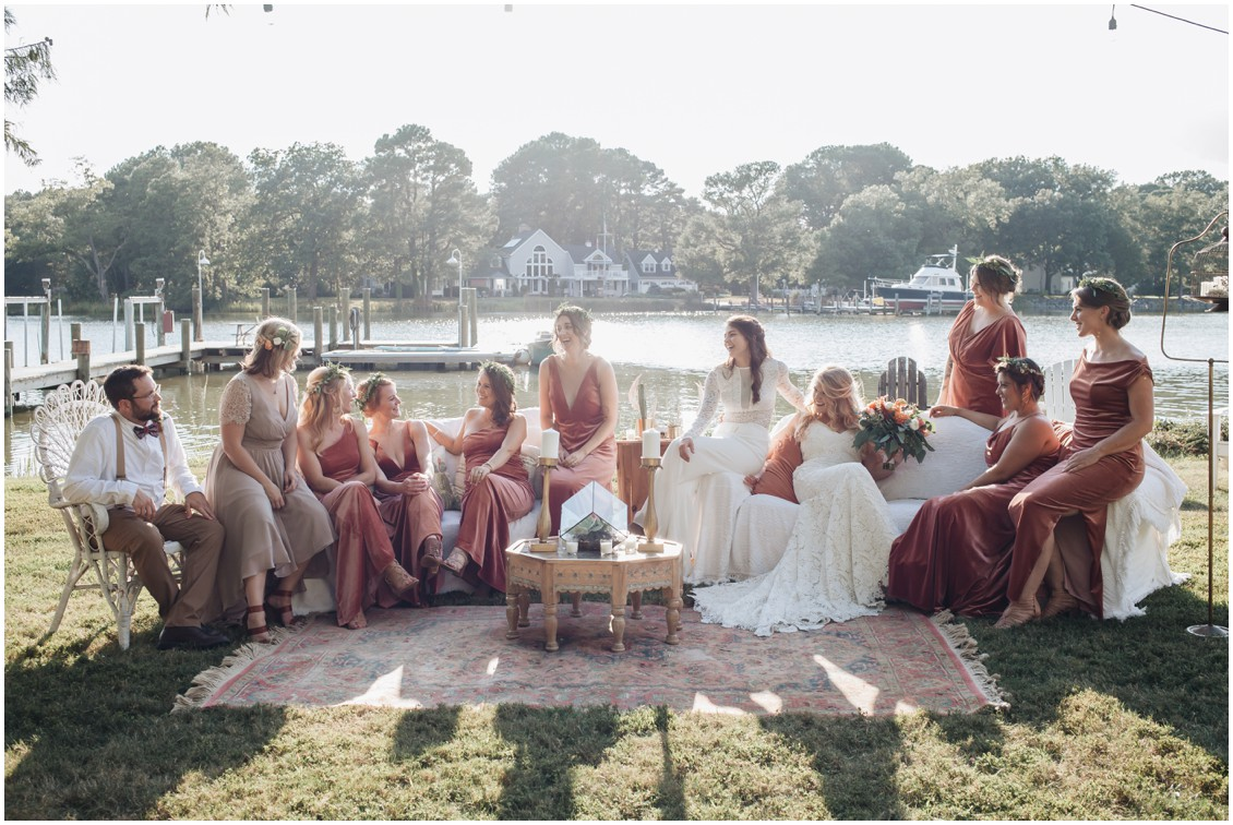 Brides and bridal party on sofas at beautiful boho style wedding | My Eastern Shore Wedding | Sherwood Florist | Cecile Storm Photography