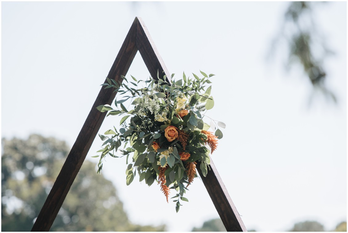Floral accents on geometric arch at boho style wedding | My Eastern Shore Wedding | Sherwood Florist | Cecile Storm Photography