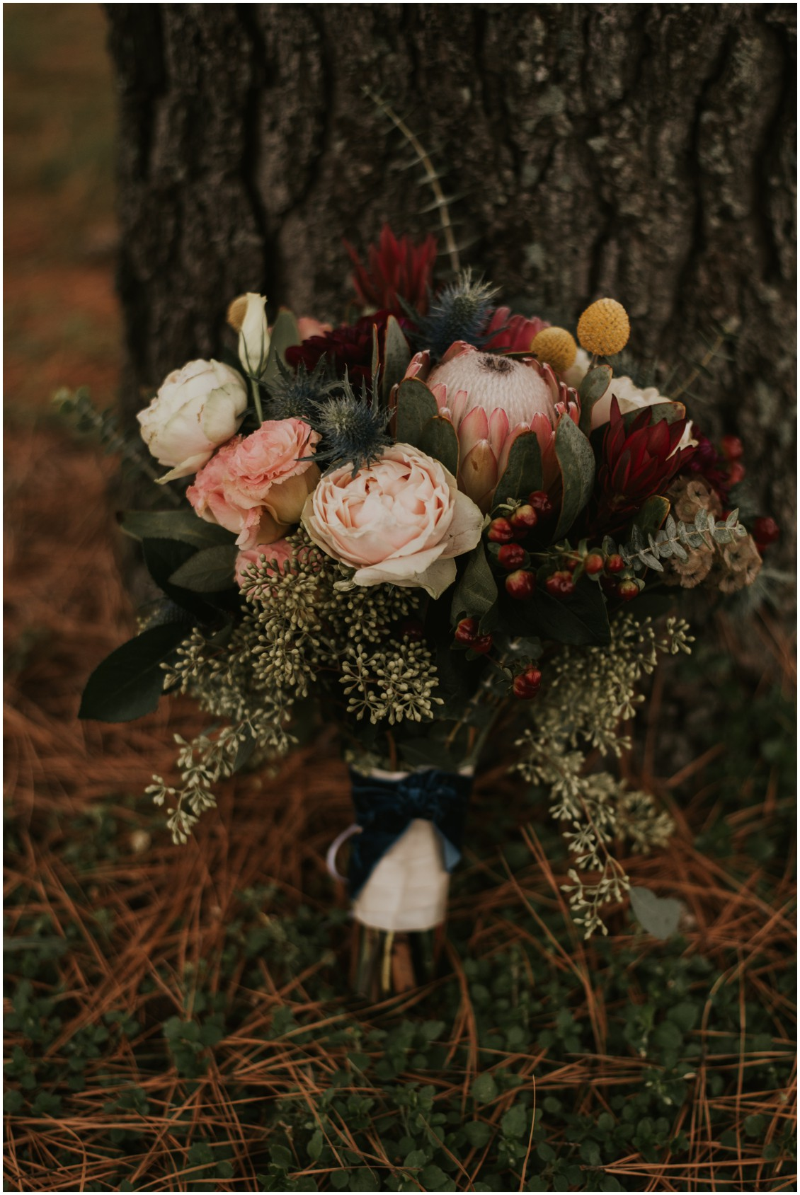 Detail shot of bridal bouquet with king protea and thistle | My Eastern Shore Wedding | Bear Trap Dunes | Coastal Tented Events