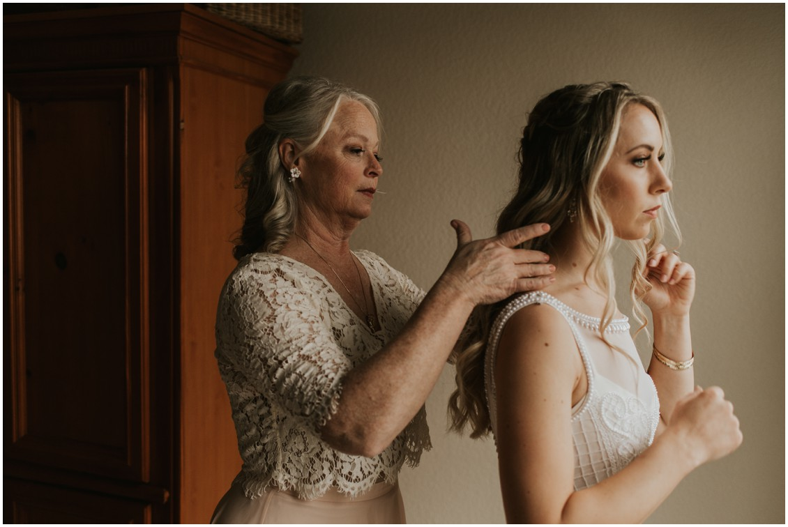 Mother of the bride helping bride in winter wedding | My Eastern Shore Wedding | Bear Trap Dunes | Coastal Tented Events