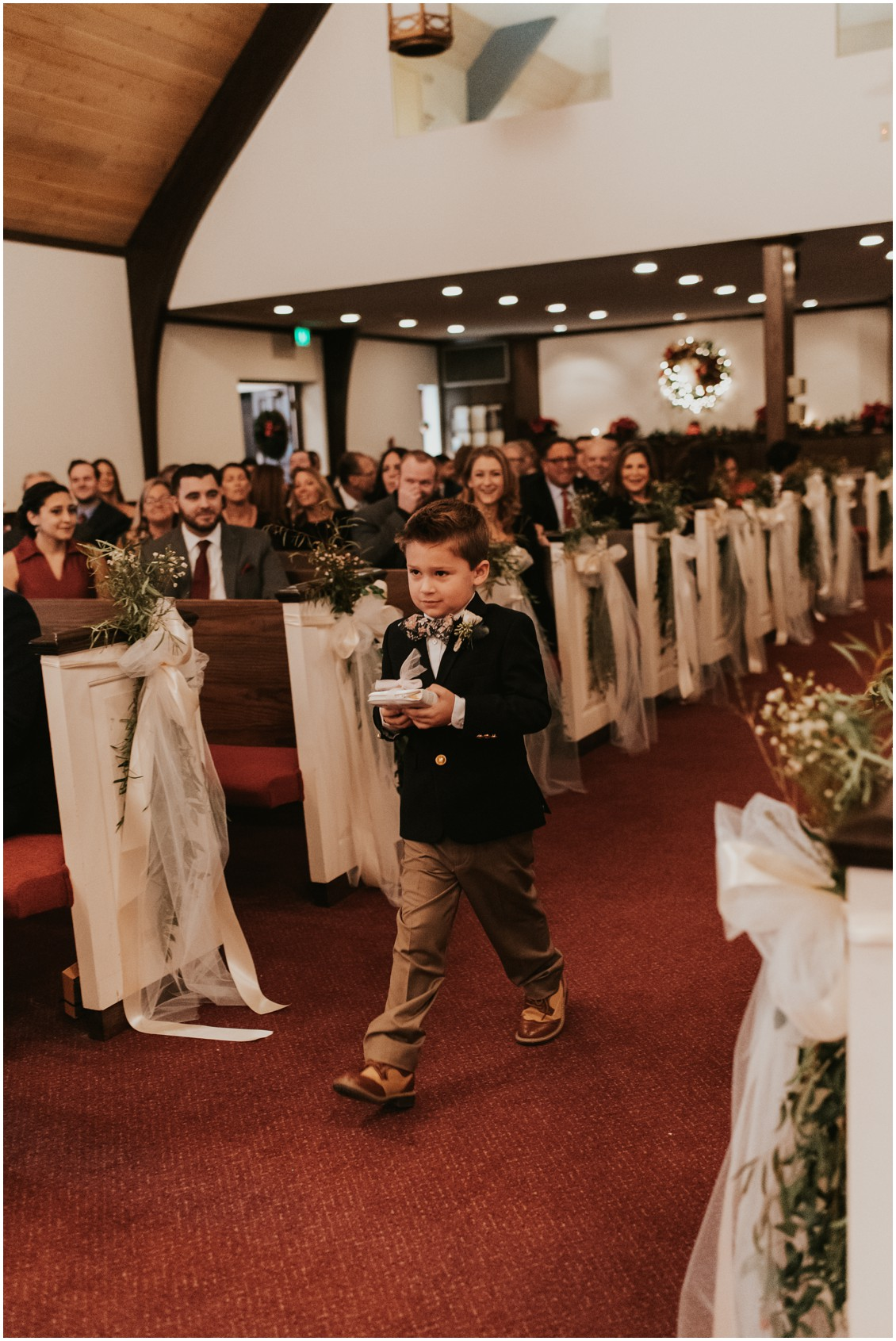 Ring bearer walking aisle at church in winter wedding | My Eastern Shore Wedding | Bear Trap Dunes | Coastal Tented Events