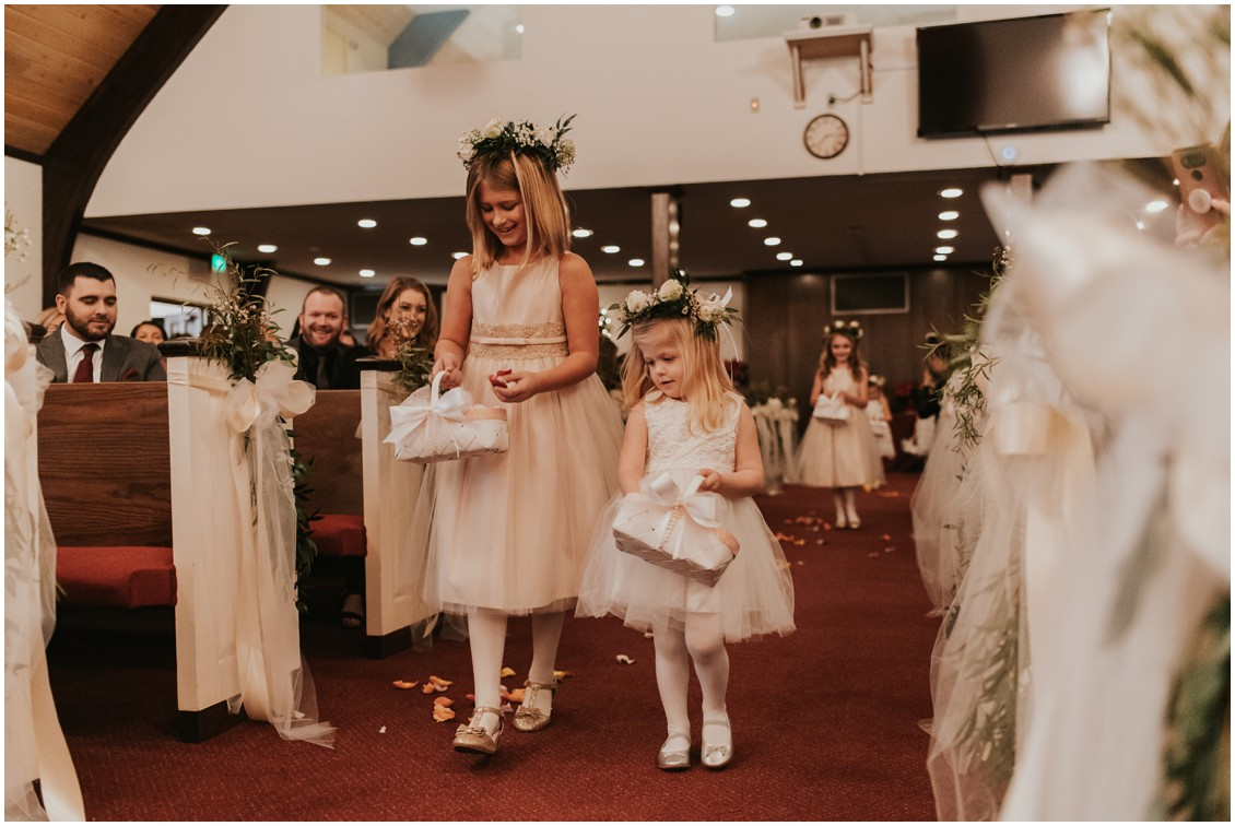 Flower girls walking aisle at church in winter wedding | My Eastern Shore Wedding | Bear Trap Dunes | Coastal Tented Events