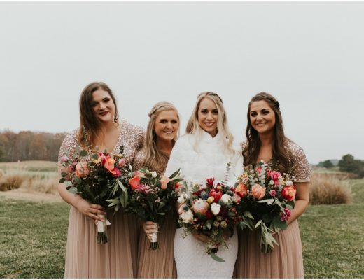 Bride in fur stole at winter wedding with bridesmaids