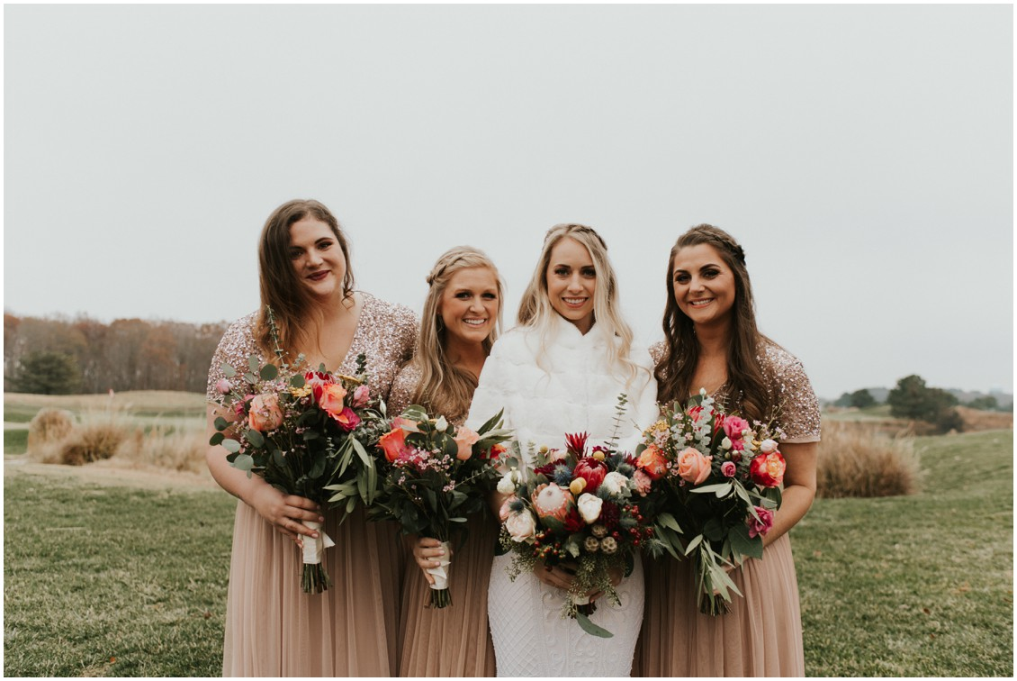 Bride wearing a fur stole and bridesmaids in in blush with sequins in winter wedding | My Eastern Shore Wedding | Bear Trap Dunes | Coastal Tented Events
