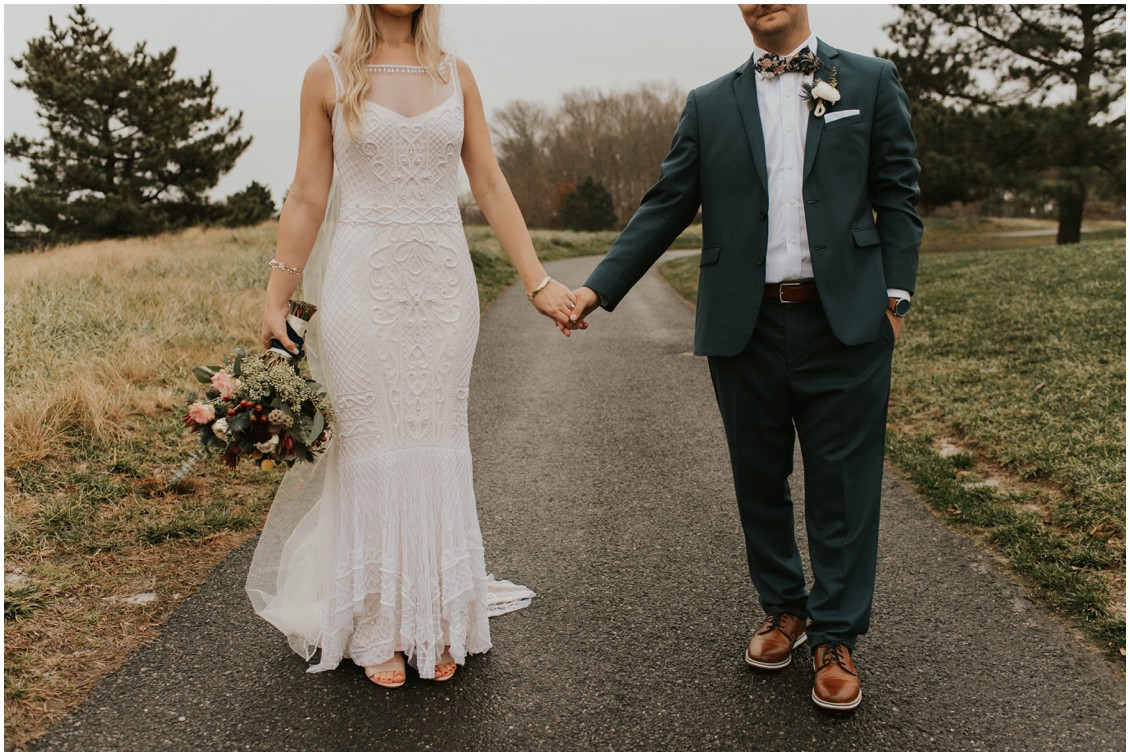 Bride and groom holding hands on golf course path | My Eastern Shore Wedding | Bear Trap Dunes | Coastal Tented Events