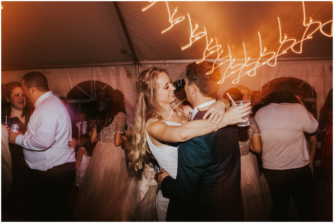 Bride and groom dancing with glow stick details  | My Eastern Shore Wedding | Bear Trap Dunes | Coastal Tented Events