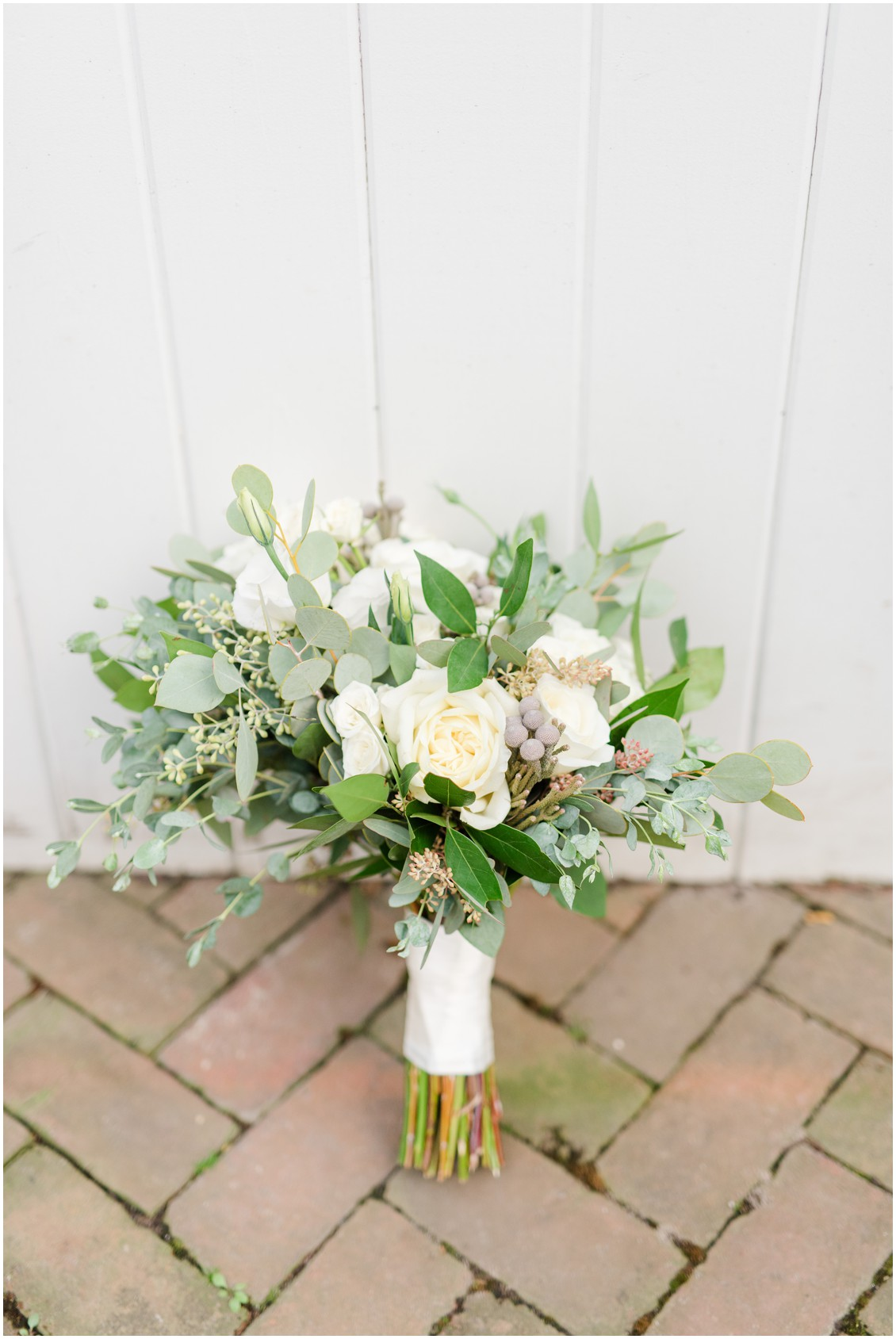 Bridal bouquet detail shot on brick walkway | My Eastern Shore Wedding | The Tidewater Inn