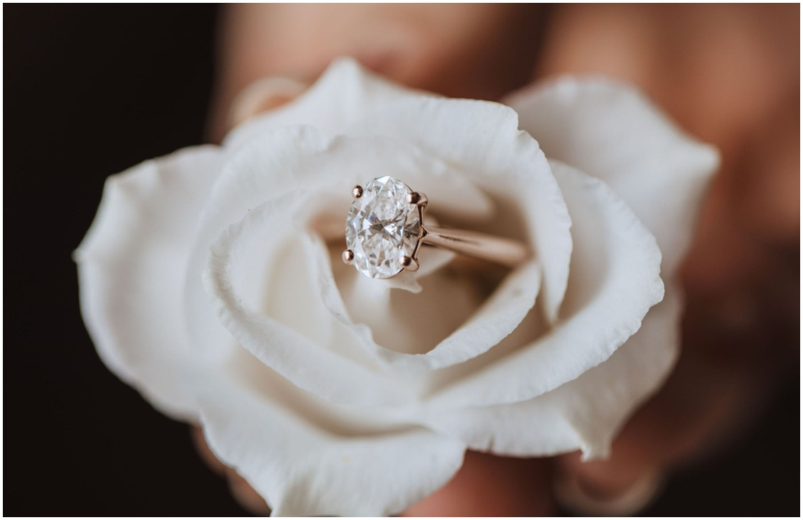 Detail of oval diamond ring on a white rose | My Eastern Shore Wedding | Chesapeake Bay Beach Club