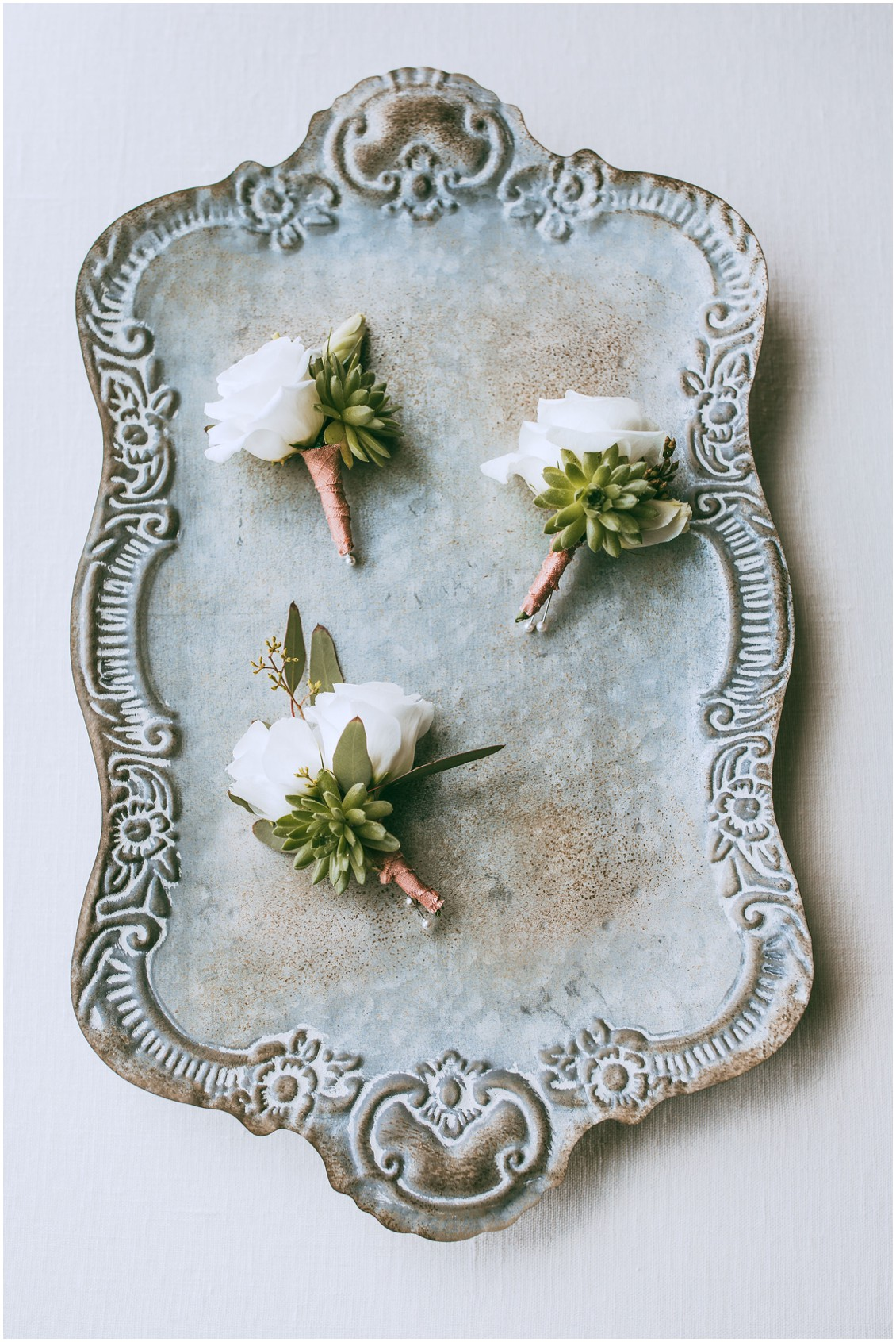 Boutonnieres on a copper patina tray | My Eastern Shore Wedding |